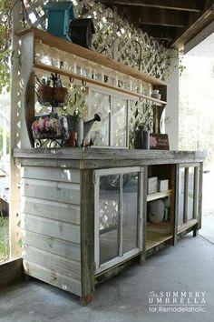 http://www.remodelaholic.com/2015/02/build-potting-bench-reclaimed-wood-windows/