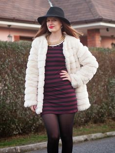 Black tights, striped dress and white furry coat