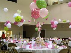 This is a baby shower I decorated (with the help of many volunteers) for some close friends. We were given the materials and vision and went right to work. We used pinks, greens, and polka dots to give a contemporary look. Instead of having a cake table we put cupcakes on each table in cupcake stands and glass pedestals. We attached balloon bouquets to the stands to create an elegant center piece. Above every other table hung a pom pom arrangement from wiring set up across the room (gym). At…