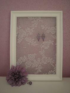 Lace and a picture frame to make an earring holder :)