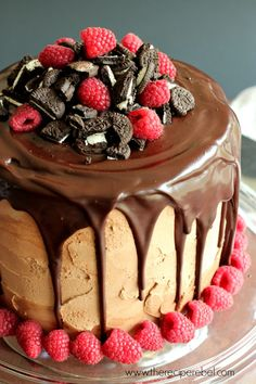 Raspberry Oreo Mocha Cheesecake Cake -- fudgy mocha chocolate cake and creamy raspberry oreo cheesecake layers frosted with mocha frosting and covered in mocha ganache. Total decadence!