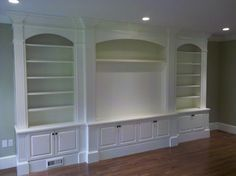 Built-in book shelves and focal point for art or TV.   Look around!