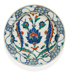 An Iznik polychrome pottery dish with lotus blossom and saz leaves, Turkey, second half 16th century | lot | Sotheby's