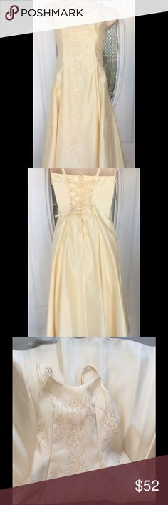 """Pale Yellow Detailed Junior Bridesmaid Formal Exquisite!  Sparkly yellow seed size beading down the front and on the two side front panels.Satin lined and a lower layer of netting to make the skirt stand out.  Double spaghetti strapsElastic across the back of the dress for and corset style tie up for Back accent.  A simply gorgeous dress!  Photo #7  shows the only flaw.. a """"dot"""" of a stain.. about the size of a pencil eraser.  May be a wine stain.  The dress is immaculately clean, and I do…"""