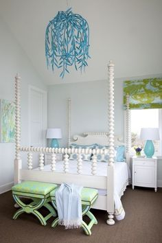 Turquoise blue & green bedroom with white four poster bed, green & blue x-bench ottoman seats chinoiserie print blind curtain
