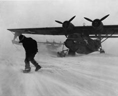 The Japanese invaded two islands, Attu and Kiska, in the Alaskan archipelago in 1942 - mostly to annoy and divert the U.S. A year later, Attu was taken back in a sharp 18-day battle; Kiska was abandoned. Operations in the ALeutians were hampered by incessantly foul weather. Fortunately, a Catalina flying boat was uniquely equipped to land on this snow-covered runway. Float Plane, Flying Boat, Aircraft Design, War Machine, Military History, Military Aircraft, World War Ii, Alaska, Fighter Jets