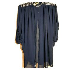 Top Navy studded neck top with balloon sleeves and  buttoned front. Top is sheer with an inside shell. Can be worn with shell or without. Runs big. Shell is 97% polyester, 3% spandex and outer top is 100% polyester Gracia Tops Blouses