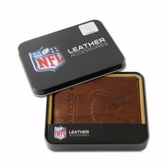 NFL Atlanta Falcons Embossed Passcase by Rico. $19.88. ID window and credit card pockets. Team logo embossed to last. Genuine cowhide brown leather. Genuine leather billfold embossed with team logo. You can store your money, credit cards and important business cards in this Atlanta Falcons embossed billfold wallet from RICO®. The genuine leather wallet holds 4 credit cards and includes a plastic picture insert, so you can show off your favorite pictures from t...