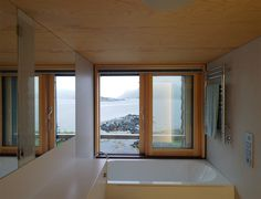 Knut Hjeltnes - Weekend house, Straume 2016. Located on a small island in place of an old warehouse that was washed away in a hurricane. The new prefabricated structure is built with a series of...