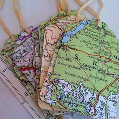 world atlas gift tags.  also make paper airplanes with old atlas pages.
