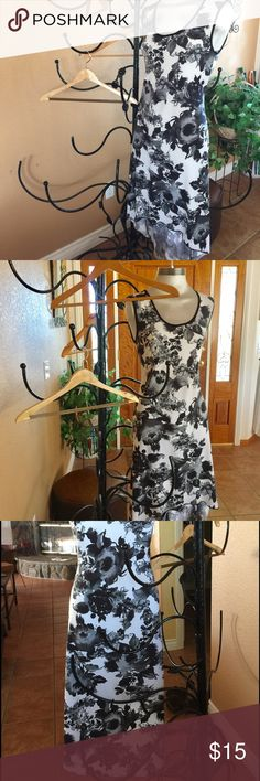 Dress, shorter in the front & longer in the back. Floral dress in black white and gray. Shorter in type front & long in the back. Any occasion. I would wear me with a blazer or shorty sweater. Jakin & Boaz Dresses Asymmetrical
