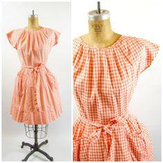 Orange gingham Swirl Wrap dress.