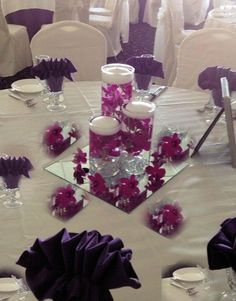 Different candle centerpiece.  Submerged flowers