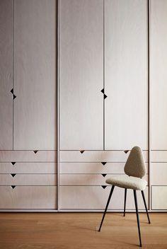 a wall of light-colored wood closets and a small chair Bedroom Closet Design, Wardrobe Design, Closet Designs, Wall Of Light, Ny Loft, Loft Studio, Muebles Living, Door Design, Interiores Design