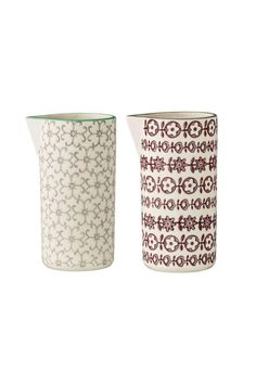 "This set of two 5"" pitchers could be used in many ways in your kitchen, from cream to syrup to dressings to sauces. One is shades of gray and cream and one is shades of burgundy and cream. They would also be great vases to dress up your table. Ceramic Pitcher Set by Bloomingville. Home & Gifts - Home Decor - Dining - Serveware Montana"