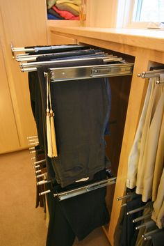 We are big fans of utilizing every cubic inch of space. The idea of bigger being better is pretty yesterday. That is why we look to cool functional hardware solutions like these pants pullouts. If you're going to remodel, make it count.