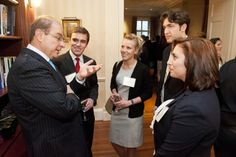 "President Joseph E. Aoun spoke with selected NU students at the reception for the ""Huntington 100,"" a group of high-achieving juniors and seniors. Photo by Brooks Canaday."
