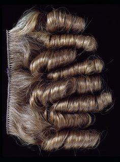Human hair sewn unto a braid foundation, British, ca. 1850's-80's. V, nr. AP.24-1889