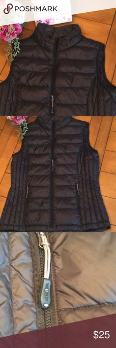 """LADIES. NWOT SUPER LIGHTWEIGHT BLACK PUFFER VEST Brand New! No tags attached because my daughter of course rips them off before she ever wears her items and decides she doesn't want them! This has to be the perfect transition jacket/vest for winter into spring. Lightweight, soft, and just perfect for the right person that doesn't want to wear that medium weight jacket as the weather turns warmer!  You will not be disappointed! Zip up  Two side zippered pockets  18"""" armpit to armpit lying…"""