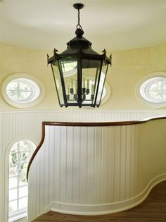 Great railing detail - curved beadboard with stained wood cap rail, very nautical! - APD Architects