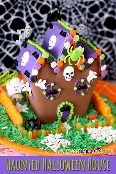 Haunted Halloween Gingerbread Cookie House.  So fun to make with the kids, and it makes an adorable Halloween centerpiece.
