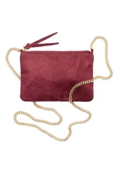 Small shoulder bag: Small shoulder bag in imitation suede with a zip at the top and a narrow shoulder strap. Lined. Size 14x20 cm.