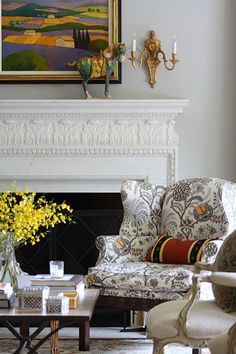 Amy-Hirsch-Living-Room-1- Love the arm chair fabric!