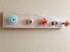 DIY Anthropologie-knob coat rack. Can someone please make this for me for Brylee's Nursery?!?!? I need 6 knobs to hang the letters of her name on!