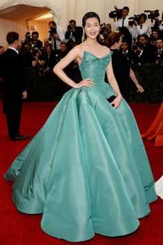 When we first spotted Liu Wen's red-carpet ensemble, we were inclined to wax poetic about the look for hours. There are ocean waves of ruffles along her ball gown and a perfectly stiff, slightly asymmetric bodice, and it's the loveliest shade of jade. Of course, we could go on and on about this Zac Posen piece, but, instead, it just left us dumbfounded and in a state of ...