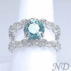 Ohhh...the center stone is the color of the Caribbean.  Gorgeous.