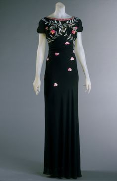 1938 Evening Dress by Elsa Schiaparelli: Silk crepe, plastic, sequins, and silk thread embroidery.
