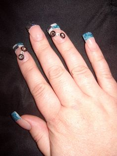 Black and teal glitter French and checkerboard (right hand)