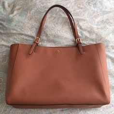 """Tory Burch Large York Tote In luggage. Like new! Only used twice.  Holds a full day's essentials, plus a 15"""" laptop and an extra pair of shoes Flat leather shoulder straps with 9"""" (23 cm) drop 1 interior padded zip compartment at center, 2 open pockets, 1 hanging zip pocket 2 drop-in pockets on exterior of hanging zip Height: 11"""" (28 cm) Length: 15"""" (37 cm) Depth: 6"""" (17 cm)   Saffiano leather Tory Burch Bags Totes"""