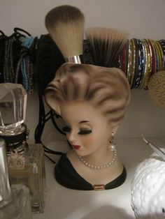 vintage head vase. Exactly what I want to do with mine! Use to hold makeup brushes!