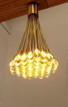 """Glass LED Lighting: 2"""" glass spheres individually backlit by 1W LEDs, connected with easily customizable mini-stems, to form clusters of refracted light in any shape or size.  Shown with 54 modules."""