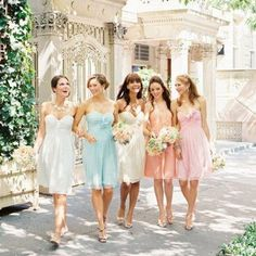 Love the different pastel bridesmaid dresses... No orange, white or cream... Add mint and purple