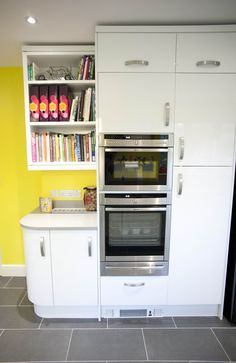 A beautiful White Gloss Curved Kitchen which has been brightened up with sunny yellow walls! German Kitchen, Bespoke Kitchens, Yellow Walls, Kitchen Design, Kitchen Appliances, Beautiful, Home, Diy Kitchen Appliances, Home Appliances
