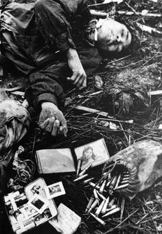 dead North Vietnamese soldier with a picture of his girlfriend/wife in his wallet - photo Don McCullin This image depicts a very tragic scene. Many would consider this to be too sad and insensitive and others find it a story that would speak to the public.