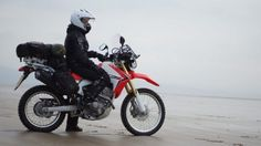 Women Who Ride: Steph Jeavons on her Honda CRF250L on a beach in Wales