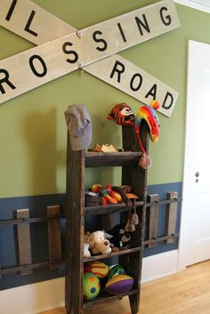 I really like the train tracks on the wall.  And the shelves made from a salvaged step ladder.