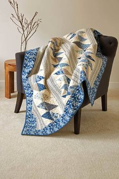 """Start with precut 2½"""" jelly roll strips and finish an easy throw quilt pattern that looks like it took a ton of time to make! Token, by Tricia Lynn Maloney, is so much fun to make! Get the quilt kit while supplies last."""