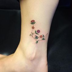 Constellation tattoo with flowers instead of stars