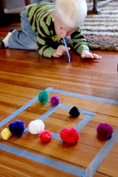 Set up a simple target practice for preschoolers using pom poms! It's an easy version that preschoolers and even toddlers can try and its fun for them! Preschool Christmas Games, Winter Activities For Kids, Preschool Games, Games For Toddlers, Preschool Crafts, Kid Activities, Indoor Activities, Preschool Ideas, Indoor Party Games