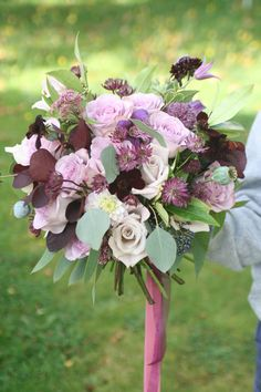 loose style wedding bouquet in pink, lilac and plum
