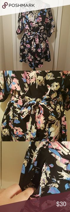 "Boutique Black Floral 3/4 Length Romper w/ Pockets Item is in excellent condition. No rips, stains, snags or tears. Measurements are laying flat and unstretched. Adorable romper! Pockets are super convenient and the overall cut and design is incredibly flattering. Bust 24"" Length 39"" Inseam 5.5"" Boutique Pants Jumpsuits & Rompers"