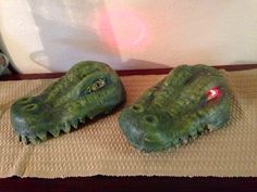 Floating Alligator heads for the swamp. Made from $ store hats filled with expanding foam, water sealed and painted. Wired with battery operated flashing eyes.
