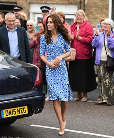 The  Duchess of Cambridge was greeted by students on the steps of the academy as locals cheered the royal couple