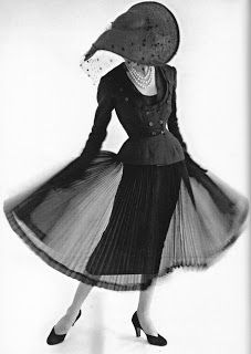 """Jacques Fath Summer 1952. """"Suit above comes with detachable pleated chiffon overskirt. The ultimate way to take a cocktail suit to a dinner suit. Lavish pleating, along with embroidery by the House of Lesage, are hallmarks of Faths work."""" (Material World: Jacques Fath)"""