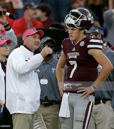 Head coach Dan Mullen talks with quarterback Nick Fitzgerald ...