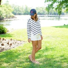 Striped hoodie, white denim shorts - A striped hoodie is a great go-to for a road trip, beach weekend, or hanging around the house
